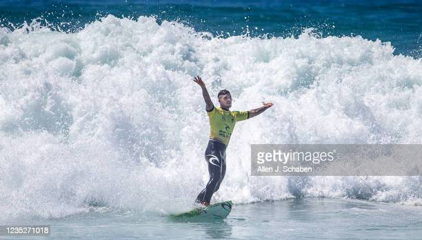 Three-time WSL World Champion Gabriel Medina, of Brazil, celebrates pulling off a big aerial maneuver, much to the delight of fans, as he beats...