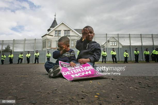 Threeyearold Ahmad Ilunga and his brother Jay four join protesters from G8 Alternatives outside Dungavel Dentention Centre on July 5 2005 Dungavel...