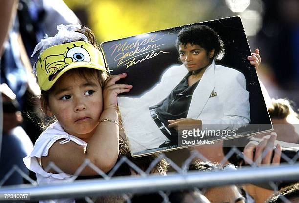 "Three-year-old Bridget Yruegas of Santa Maria, California holds a copy of singer Michael Jackson's 'Thriller"" album outside the courthouse during his..."