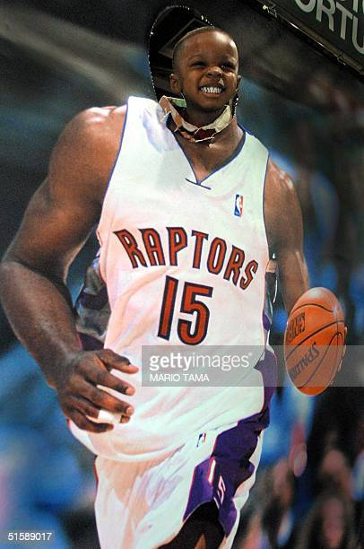 Three-year-old Evander Gray stands in a cut-out poster of NBA star Vince Carter of the Toronto Raptors prior to the 2001 NBA All-StarGame 11 February...