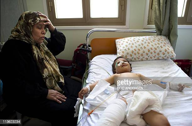 Threeyearold Heba who was found with part of her intestine hanging out of a stomach wound apparently caused by a cluster bomb over her home lies in a...