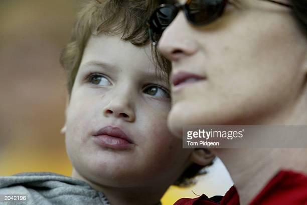 Threeyearold John Landy of Novi Michigan looks on in the arms of his mother Cristi as they share in a moment of silence during the game between the...