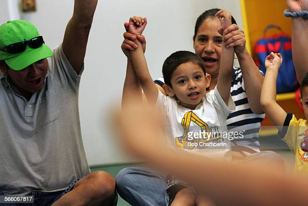 Three–year–old Jose Franco who is profoundly deaf sings 'The Ants Go Marching' during class with his mother Hilda Giron right and father Elias Franco...