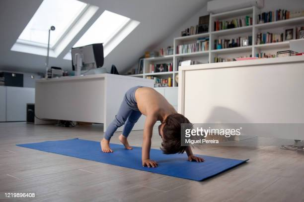 Three-year-old Lucas Bejar, son of the photographer, practicing yoga during the COVID lockdown on April 18 in Majadahonda, Madrid, Spain. Starting...