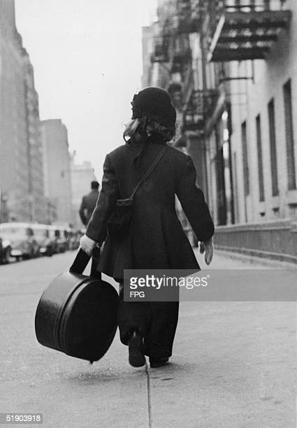 Threeyearold model Patty Burke carries a large round bag as she walks on her way to a photo shoot New York New York February 16 1953