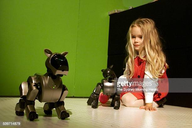 Threeyearold Samantha Craft with the new generation entertainment robot dog AIBO 5 July 2001 SMH Picture by BRENDAN ESPOSITO