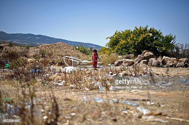 A threeyearold Syrian refugee girl plays in between plastic bags and other garbage outside the Centre for Temporary Stay of Immigrants on the north...