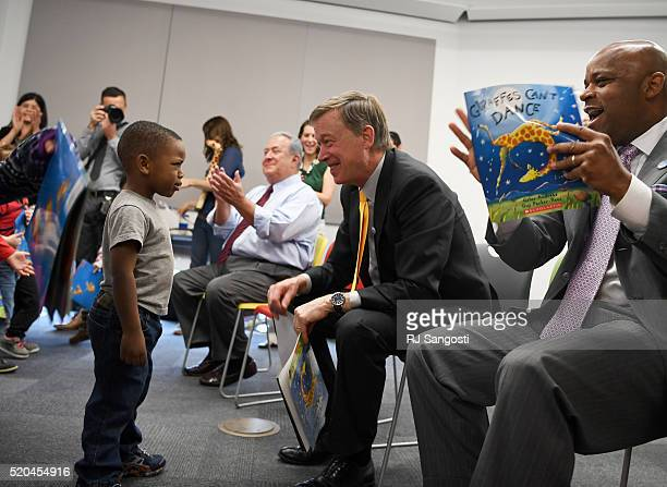 Threeyearold Tre HickmonLewis just peers at Colorado Governor John Hickenlooper when he was asked him if he could dance like the giraffe in the book...