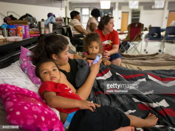 Threeyearold Xzavier Randolph his mother Amber Johnson and 4yearold sister Zaileigh play games on a mobile phone at the Crawfordville Elementary...