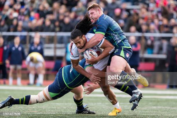 Thretton Palamo of Old Glory DC is tackled by Mike Shepherd and Tim Metcher of Seattle Seawolves during the second half of the match at Cardinal...