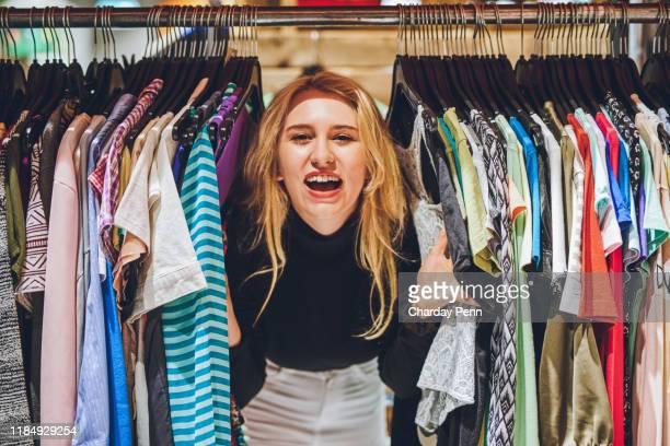 thrift shopping is all the rage! - ver a hora imagens e fotografias de stock