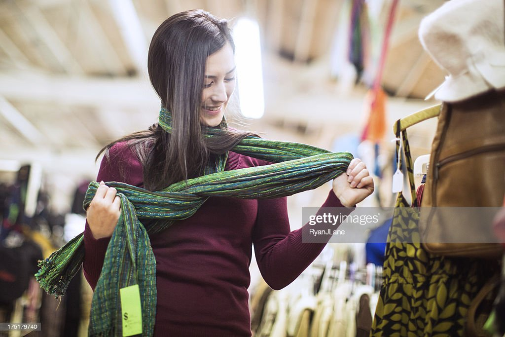 Thrift Store Shopping Young Woman : Stock Photo