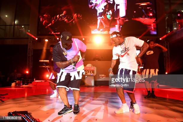 Thrill da Playa and Fast of 69 Boyz perform onstage during 5th Annual Tee Up ATL Party at College Football Hall of Fame on August 19 2019 in Atlanta...