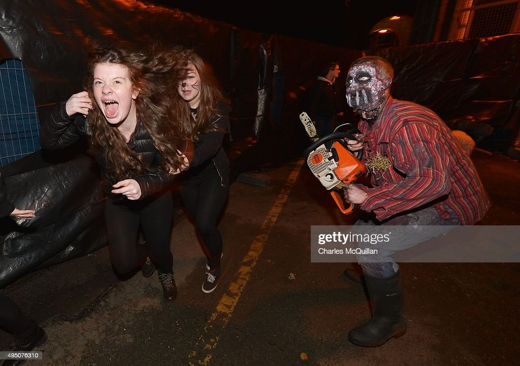 Thrill seekers react to a Chateau Le Fear cast member as he performs at the house of horror interactive walk-through show on October 31, 2015 in Londonderry, Northern Ireland. Derry hosts the biggest Halloween street carnival parade in Europe attracting some 25,000 enthusiasts and was also recently voted the number one Halloween destination in the world according to a USA Today poll.