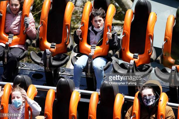 """Thrill seekers wear face masks as they ride the """"Oblivion"""" rollercoaster at Alton Towers on the first day opening after after lockdown restriction..."""