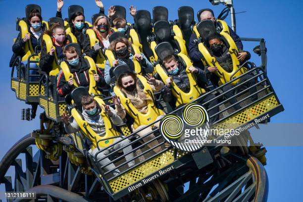 """Thrill seekers wear face masks as they ride """"The Smiler"""" rollercoaster at Alton Towers on the first day opening after after lockdown restriction were..."""