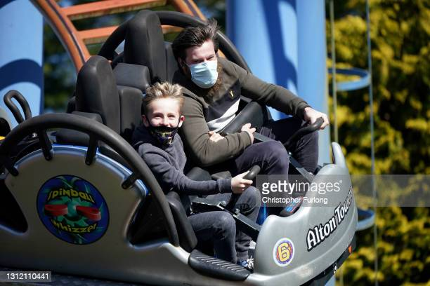 """Thrill seekers wear face masks as they ride """"The Spinball Whizzer"""" rollercoaster at Alton Towers on the first day opening after after lockdown..."""