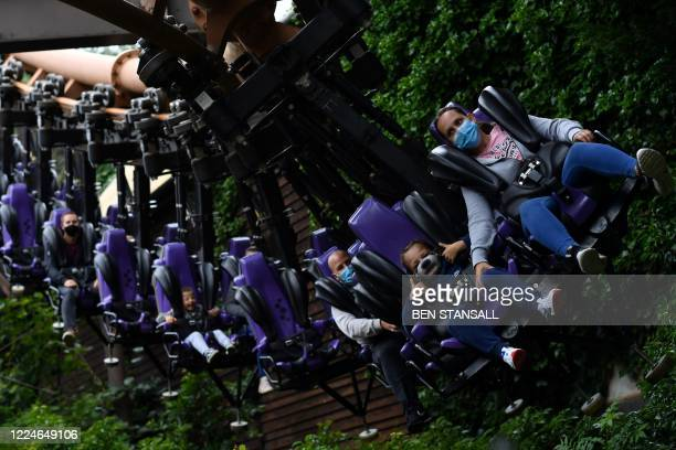 Thrill seekers wear face masks as they ride the Vampire roller coaster at Chessington World of Adventures Resort in chessington Greater London on...