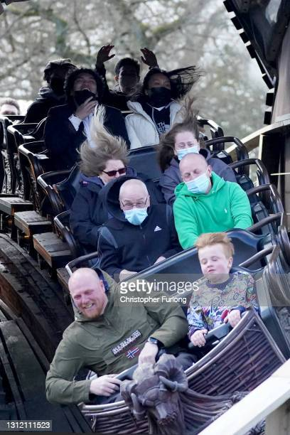 """Thrill seekers wear face masks as they ride the """"Wicker Man"""" rollercoaster at Alton Towers on the first day opening after after lockdown restriction..."""