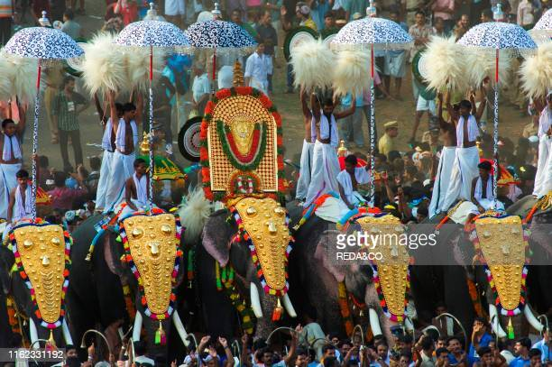 Thrissur Pooram festival the competition called 'Kudamattam' the swift and rhythmic changing of brightly colored parasols along with the raising and...