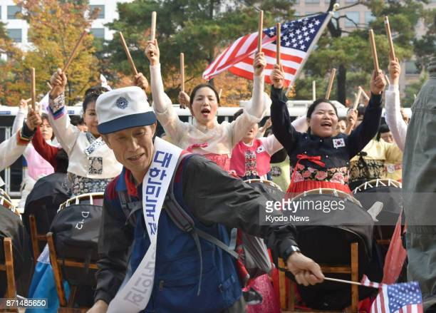 A throng of people welcome US President Donald Trump with dancing and drumming in front of the South Korean parliament on Nov 8 2017 ==Kyodo