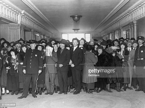 Throng packed in the Hall of Justice waiting for a glimpse of the five gangsters who are in jail for attacking young girls in Howard Street House...