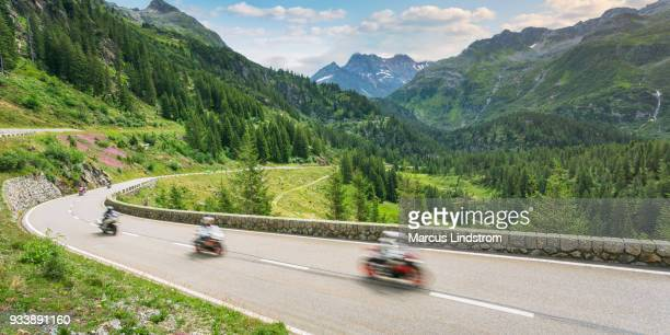through switzerland on motorcycle - mountain pass stock pictures, royalty-free photos & images