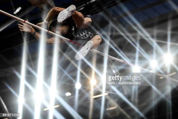Through the light France's Renaud Lavillenie competes in the final of the men's pole vault athletics event at the 2017 IAAF World Championships at...