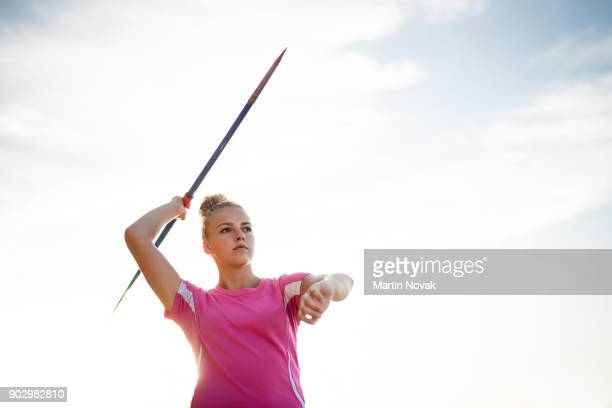 Throwing a javelin - woman training outdoor