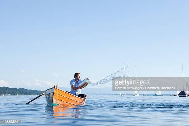 Throwing buckets of water ot ouf boat