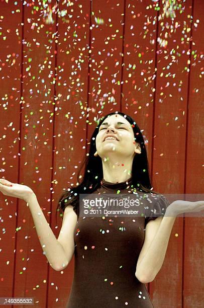 Throwing confetti in  air