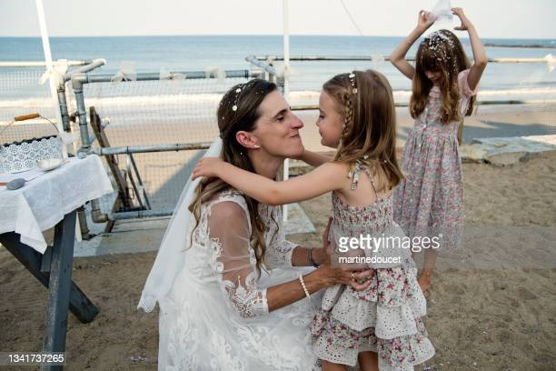 """throwing confettis at small wedding ceremony in family beach house. - """"martine doucet"""" or martinedoucet stock pictures, royalty-free photos & images"""