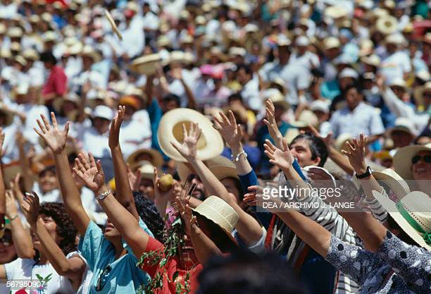 Throwing gifts to the public during the celebrations at the Guelaguetza festival Oaxaca Mexico