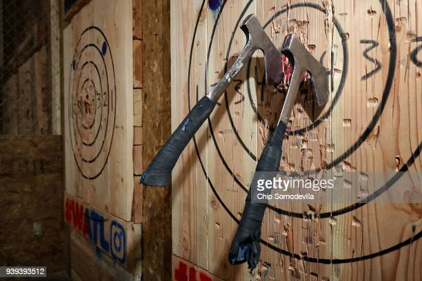 Throwing hatchets are lodged in a wood target wall at Bad Axe Throwing March 28 2018 in Washington DC Recreational axe throwing is growing in...