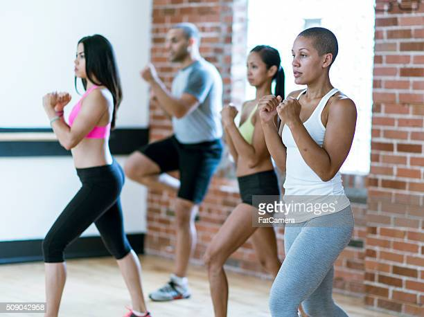 throwing punches at a kickboxing class - mixed boxing stock photos and pictures