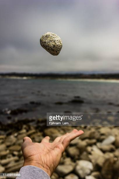 throwing rock in the air - ephraim lem stock pictures, royalty-free photos & images