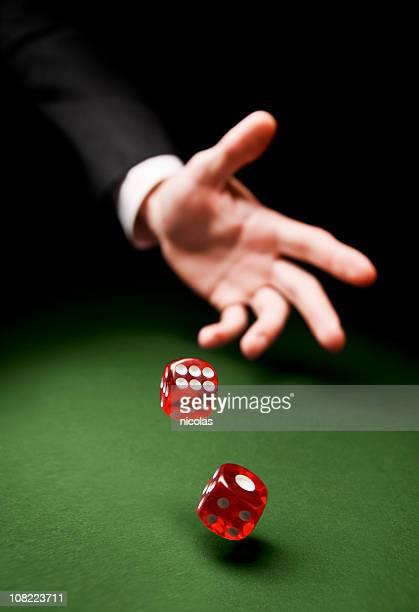 throwing the dice - dobbelsteen stockfoto's en -beelden