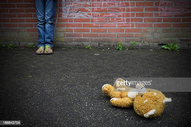 thrown away teddy bear - abuse stock pictures, royalty-free photos & images