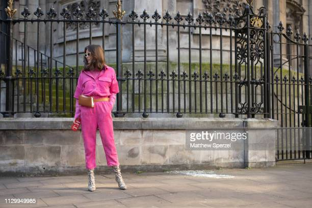 Thérèse Hellström is seen on the street wearing hot pink jumpsuit with brown hip belt bag and silver shoes during London Fashion Week February 2019...