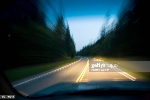 POV thru windsheild of blurred road at night