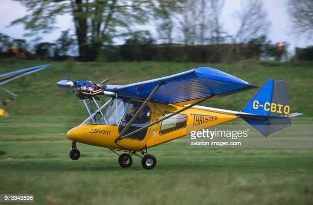 Thruster T600N 450 microlight takingoff from a grass runway