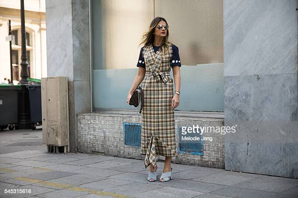 Thssia Naves wears Ray Ban sunglasses and Adidas top A La Garconne plaid yellow belt a monogrammed Louis Vuitton purse and Gucci mules at the Viktor...