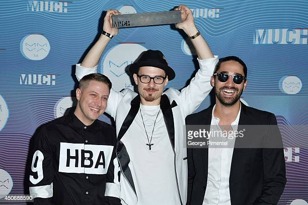 Thugli's Pat Drastik and Tom Wrecks and director Amos LeBlanc pose in the press room at the 2014 MuchMusic Video Awards at MuchMusic HQ on June 15...