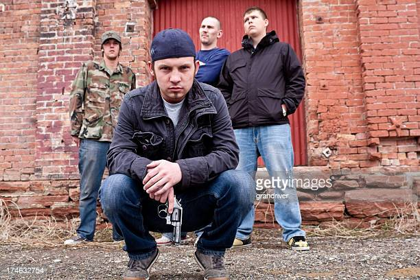 thugs with a gun - gang stock pictures, royalty-free photos & images
