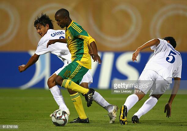 Thulani Serero of South Africa beats Angel Castro and Jose Fonseca of Honduras during the FIFA U20 World Cup Group F match between South Africa and...