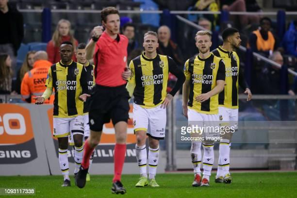 Thulani Serero of Vitesse, referee Martin van den Kerkhof , Alexander Buttner of Vitesse, Max Clark of Vitesse during the Dutch Eredivisie match...