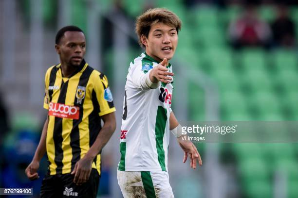Thulani Serero of Vitesse Ritsu Doan of FC Groningen during the Dutch Eredivisie match between FC Groningen and Vitesse Arnhem at Noordlease stadium...