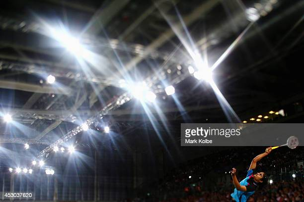 Thulasi of India plays an overhead smash as she competes in her women's singles badminton quarter-final match at Emirates Arena during day nine of...