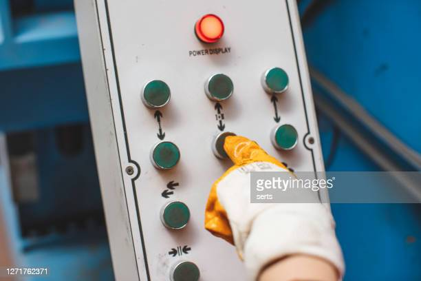 thumb touch on switch button on control panel - electrical panel box stock pictures, royalty-free photos & images