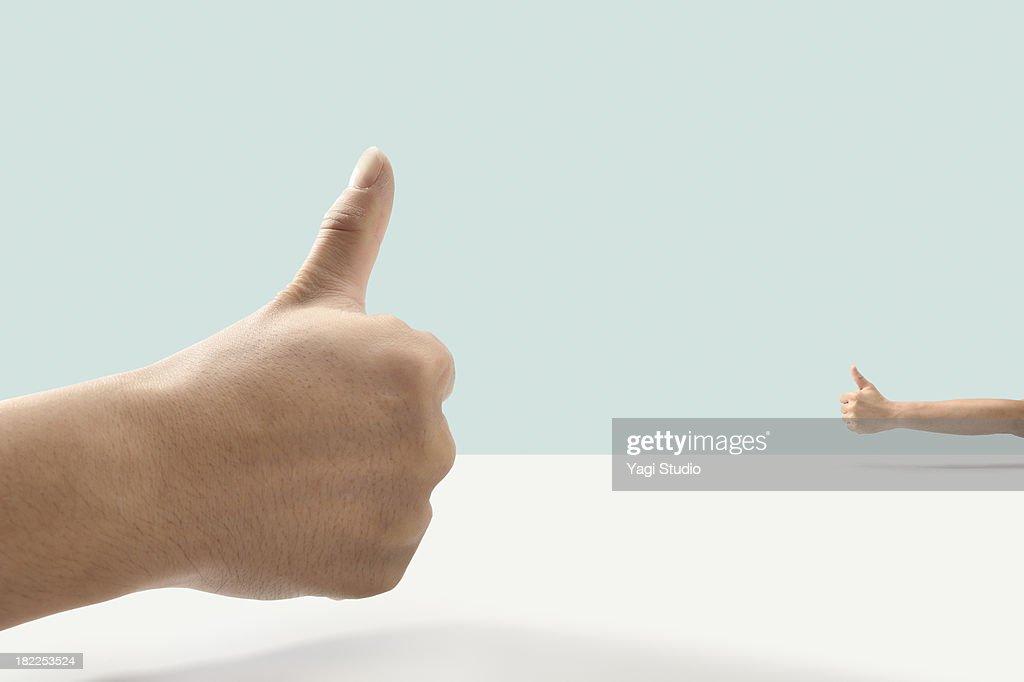 Thumb up and Thumb up : Stock Photo
